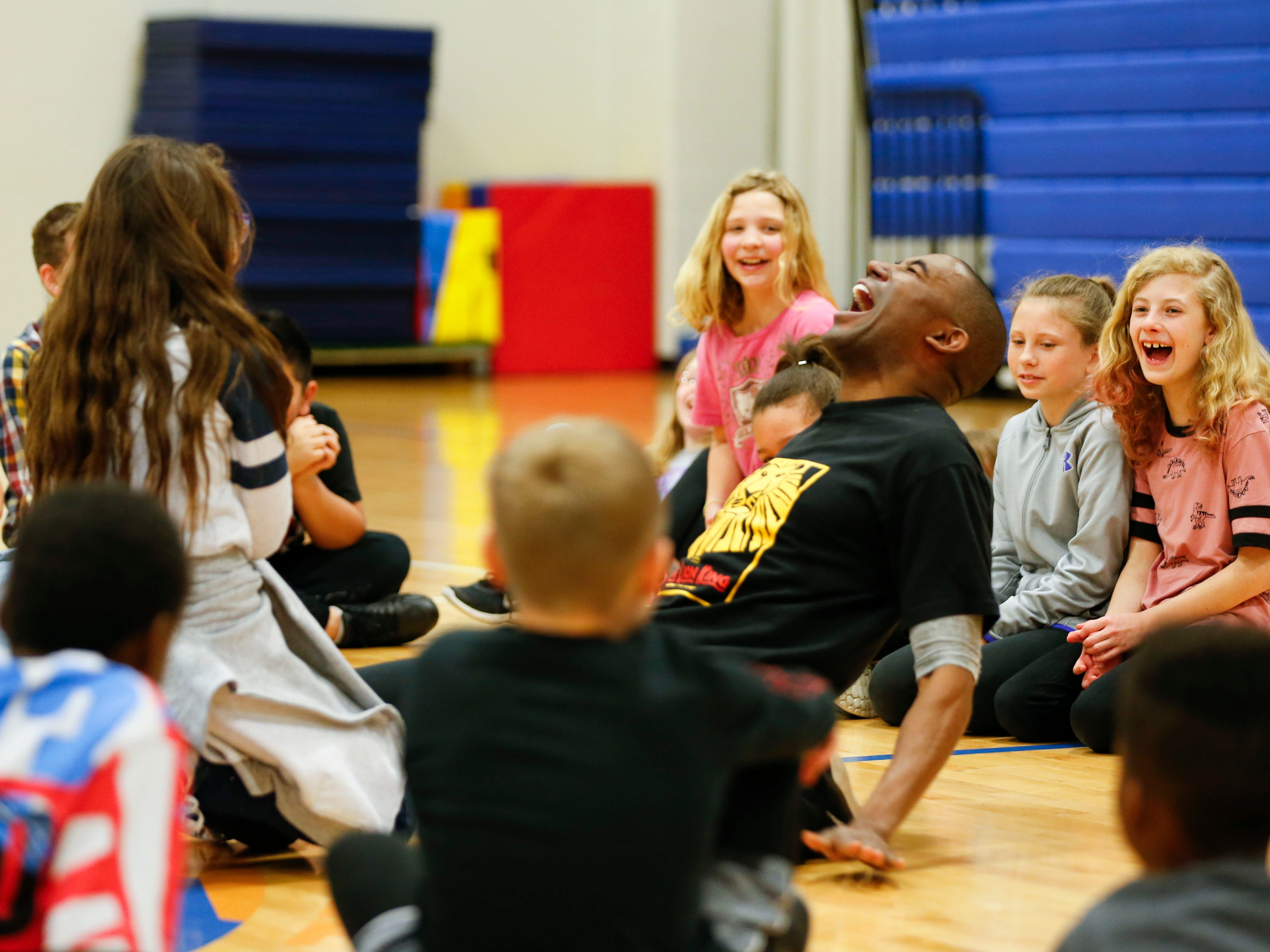 """""""Lion King"""" cast member Andrew Arrington show Fremont Elementary students his hyena laugh during a stop at the school on Tuesday, March 5, 2019."""