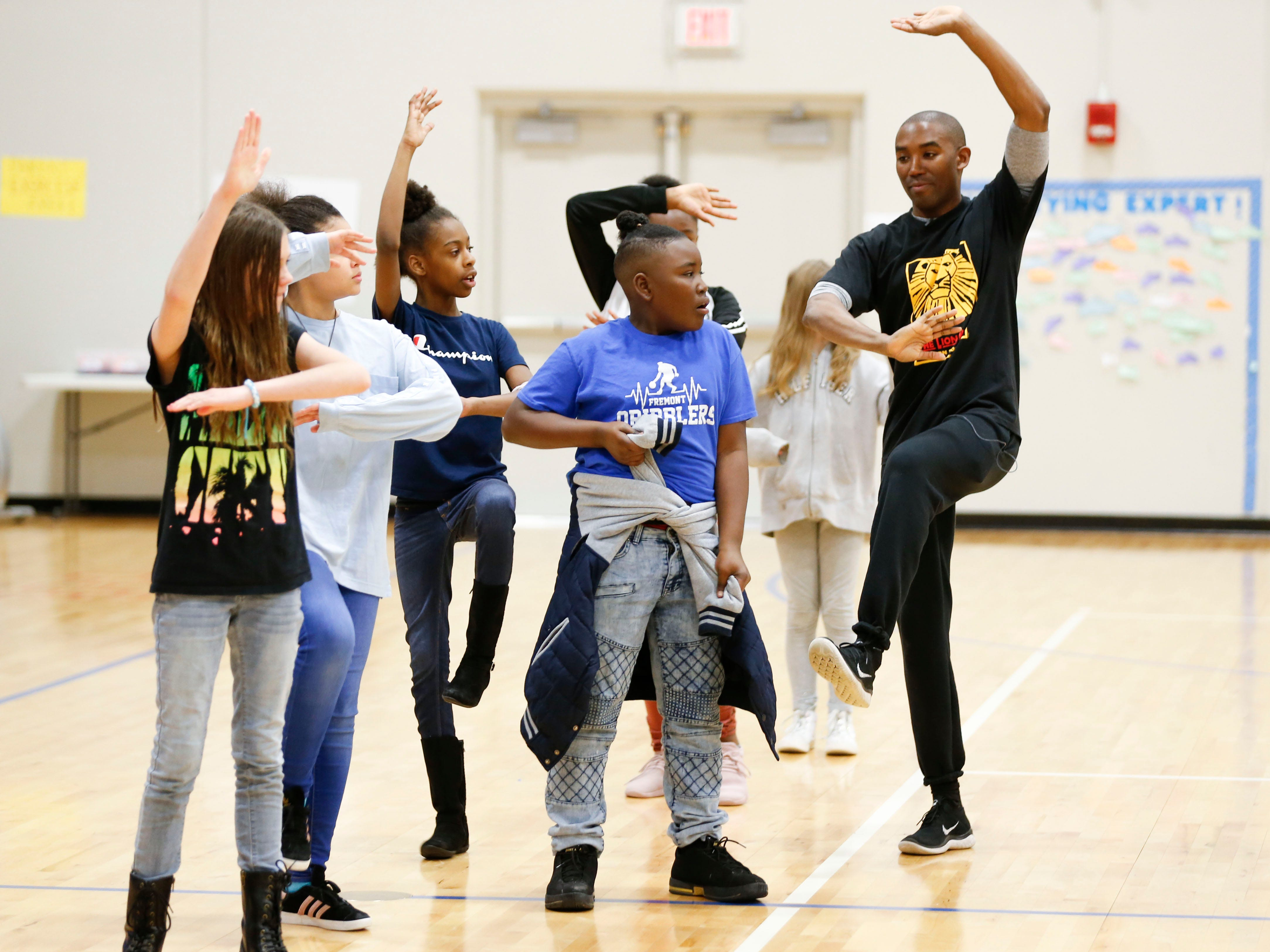 """""""Lion King"""" cast member Andrew Arrington teaches dances moves from the show to Fremont Elementary students as part of Disney's Get Up and Go Workshop on Tuesday, March 5, 2019."""