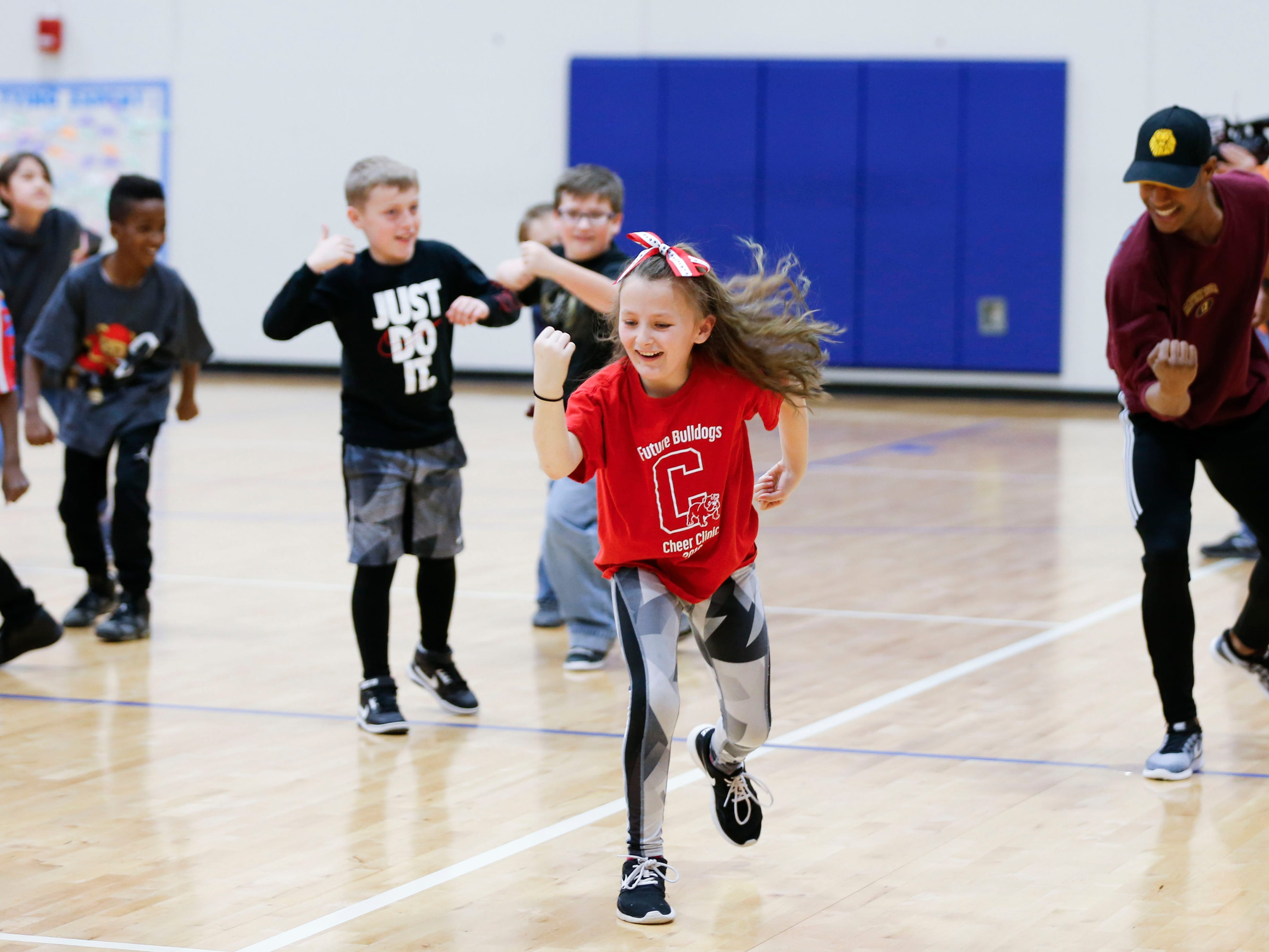 """Fremont Elementary School student Victory Stine performs dance moves taught by cast members from """"The Lion King"""" on Tuesday, March 5, 2019."""