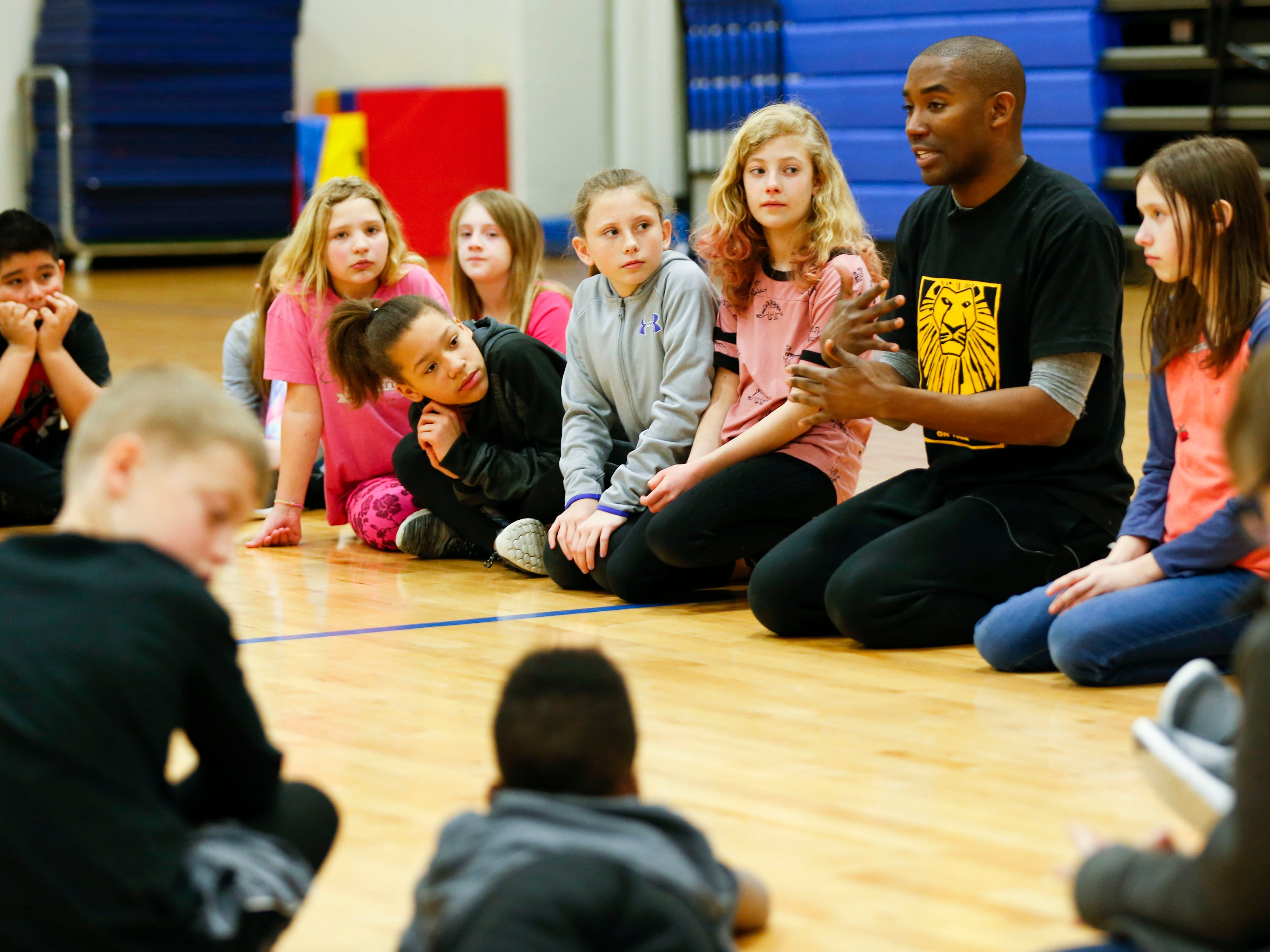"""""""Lion King"""" cast member Andrew Arrington takes questions about the production from students at Fremont Elementary on Tuesday, March 5, 2019."""