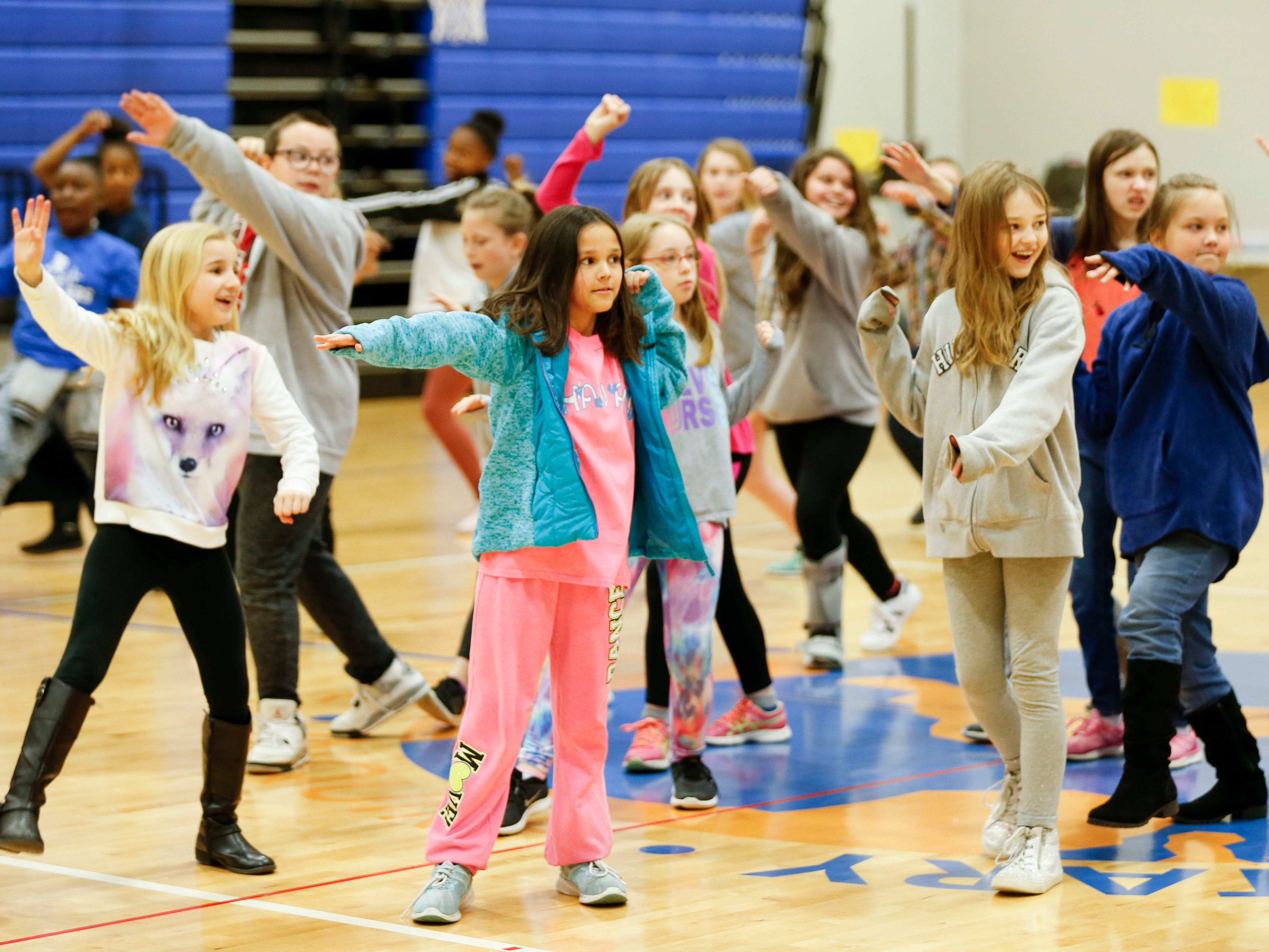 """Fremont Elementary School students learn dance moves from cast members of """"The Lion King"""" on Tuesday, March 5, 2019."""