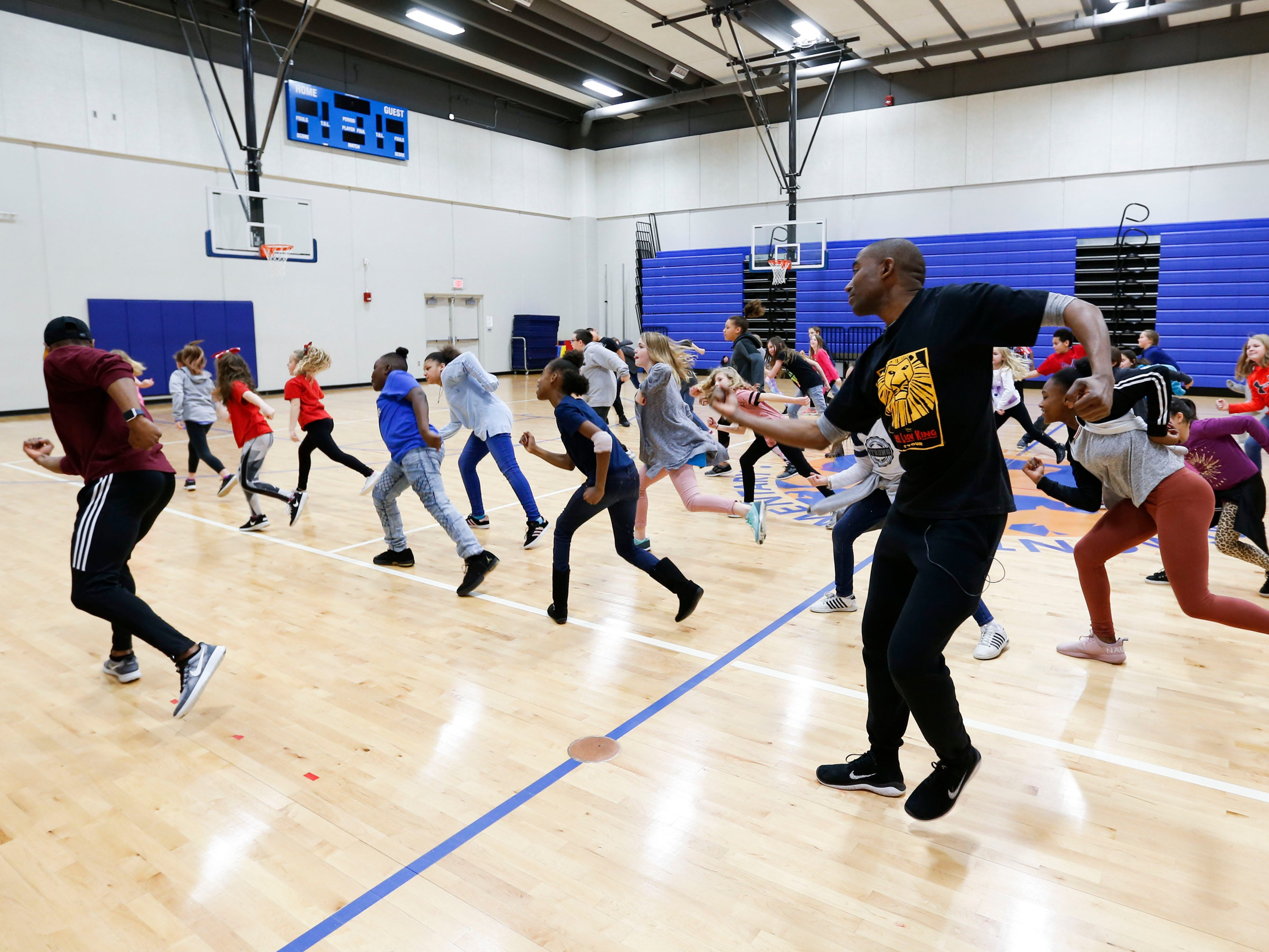 """""""Lion King"""" cast members Andrew Arrington, right, and Courtney Thomas teaches dance moves to students at Fremont Elementary as part of Disney's Get Up and Go Workshop on Tuesday, March 5, 2019."""