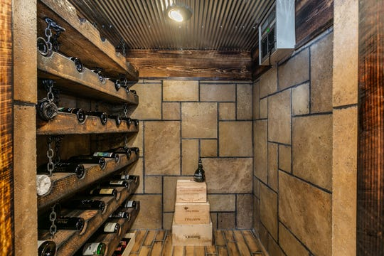 The wine cellar occupies a space that formerly was a small crawl space. It was excavated to carve out room for her wine collection. She uses a color code to let her know which wines are good to drink now and which should be saved for special occasions in the years ahead.