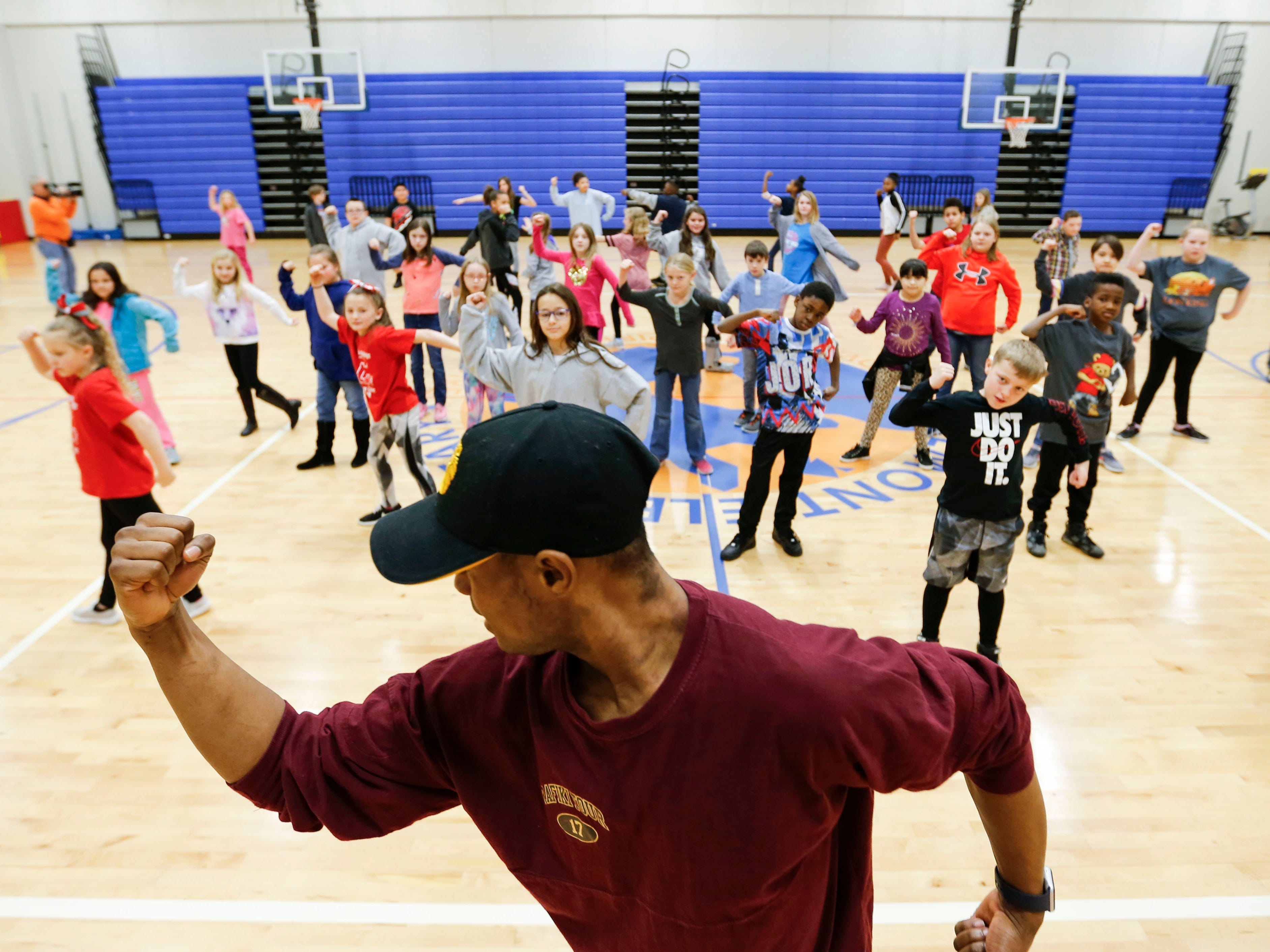 """""""Lion King"""" cast member Courtney Thomas teaches dance moves to students at Fremont Elementary as part of Disney's Get Up and Go Workshop on Tuesday, March 5, 2019."""