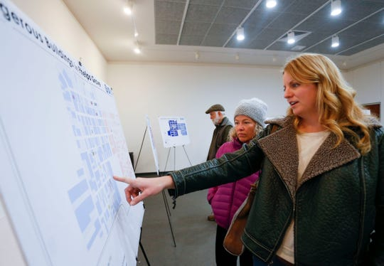 Phelps Grove residents Karen McQueary (right) and Jennifer Greer looks at posters of the neighborhood plan during a meeting at the Springfield Art Museum on Wed., Feb. 27, 2019