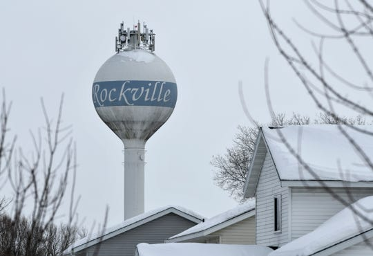 The city water tower rises above homes in Rockville Tuesday, March 5