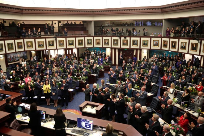 Members of the House of Representatives applaud as Lt. Gov. Jeanette Nunez is welcomed during the first day of the Legislative Session Tuesday, March 5, 2019.