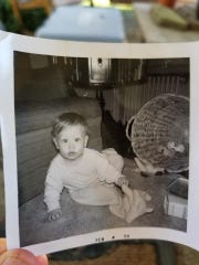 """Krista McMullen found a photo of """"Timmy"""" with the date Feb. 1959 on it about 5 miles away from where an EF3 tornado hit the Baum Community on Sunday night."""