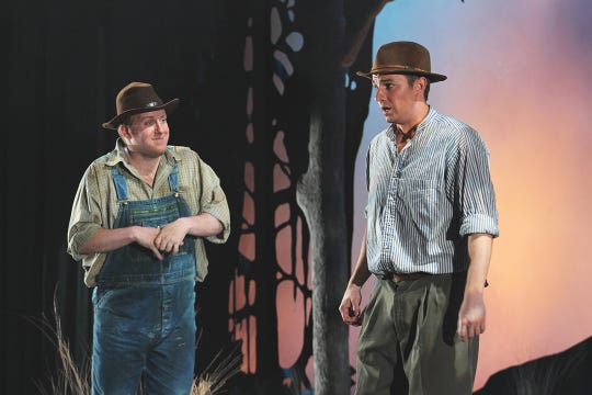 """Lennie (Luke Selker) asks George (Bret Thom) if the police are coming to get him in Florida State Opera's """"Of Mice and Men."""""""