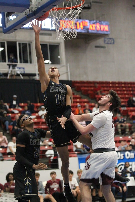 St. John Paul II senior Allan Jeanne-Rose goes up for a layup as the Panthers beat First Baptist Academy 55-37 during a Class 3A state championship game at the RP Funding Center in Lakeland on March 4, 2019.