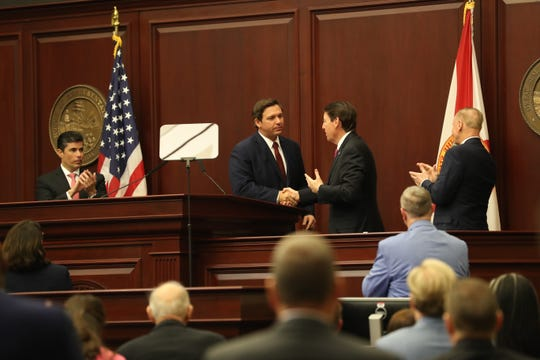 Gov. Ron DeSantis shakes hands with Senate President Bill Galvano after giving his State of the State address during the opening day of session for the Florida Legislature Tuesday, March 5, 2019.