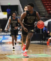 St. John Paul II's Chosen Levarity dribbles up the court as the Panthers beat First Baptist Academy 55-37 during a Class 3A state championship game at the RP Funding Center in Lakeland on March 4, 2019.