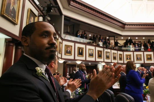 Rep. Ramon Alexander claps during the opening day of session for the Florida Legislature Tuesday, March 5, 2019.