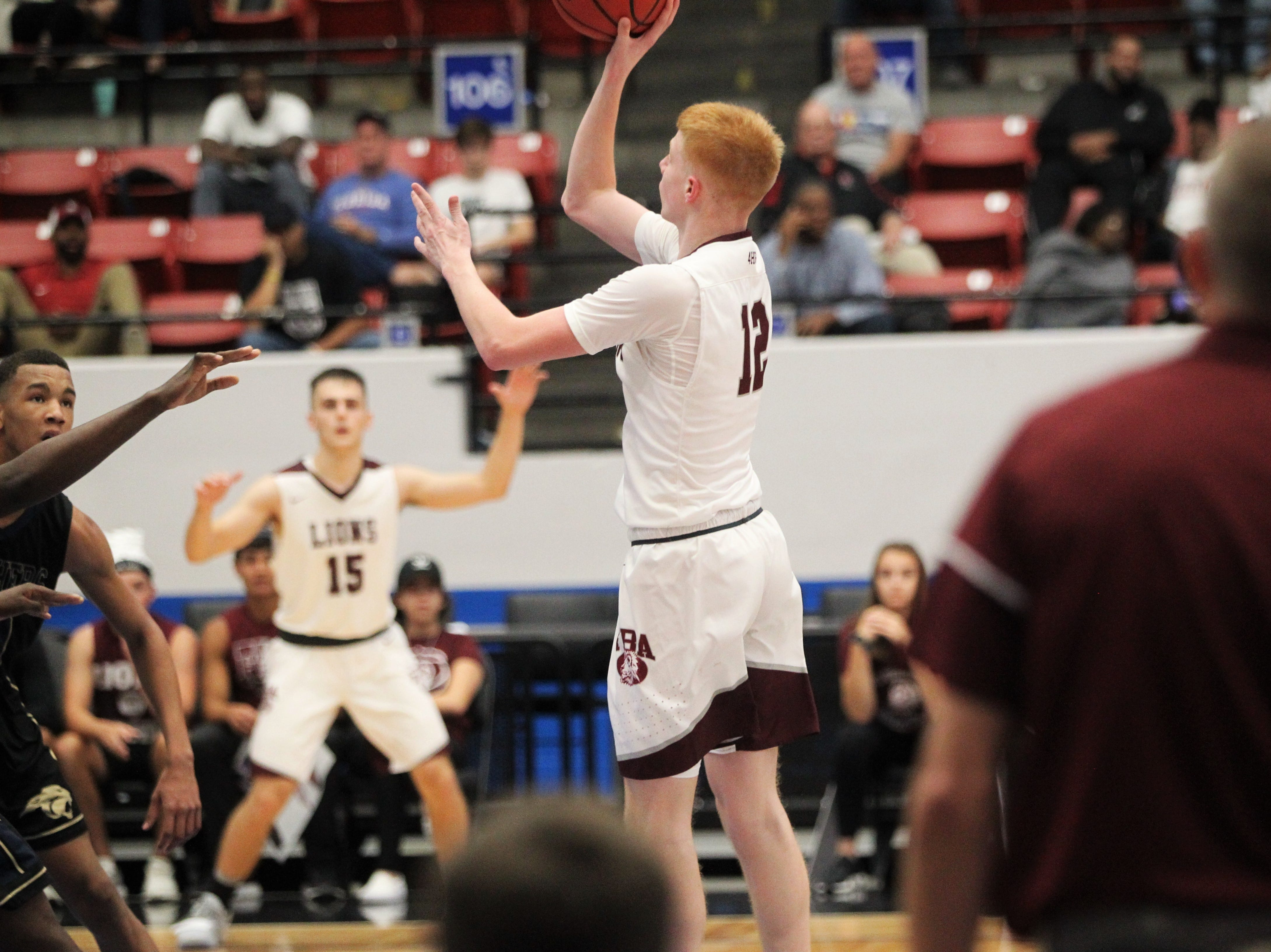 First Baptist Academy's Andrew Nottidge hits a mid-range jumper as St. John Paul II beat FBA 55-37 during a Class 3A state championship game at the RP Funding Center in Lakeland on March 4, 2019.