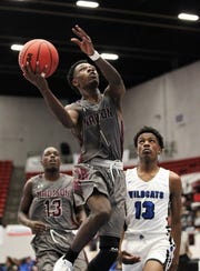 Madison County's Vincenta Mitchell drives for a layup as the Cowboys' basketball team captured a Class 1A state championship with a 62-60 victory over Wildwood at the RP Funding Center in Lakeland on Tuesday.
