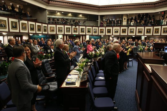 Members of the Florida House of Representatives rise and applaud during the opening day of session for the Florida Legislature Tuesday, March 5, 2019.