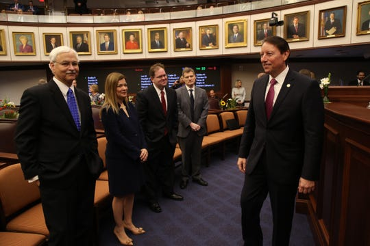 Senate President Bill Galvano greets members of the Florida Supreme Court during the opening day of session for the Florida Legislature Tuesday, March 5, 2019.