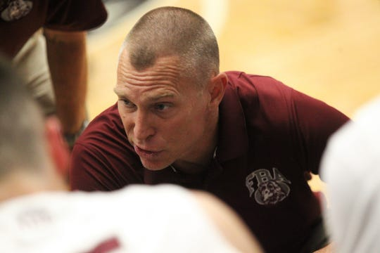 First Baptist Academy coach Scott Stewart during the Lions' 55-37 loss to St. John Paul II in the Class 3A state semifinals at the RP Funding Center in Lakeland on Monday.