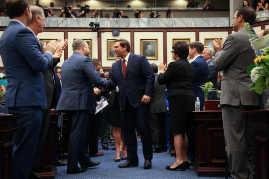 Gov. Ron DeSantis enters the House of Representatives chambers where he will gives his State of the State address during the opening day of session for the Florida Legislature Tuesday, March 5, 2019.