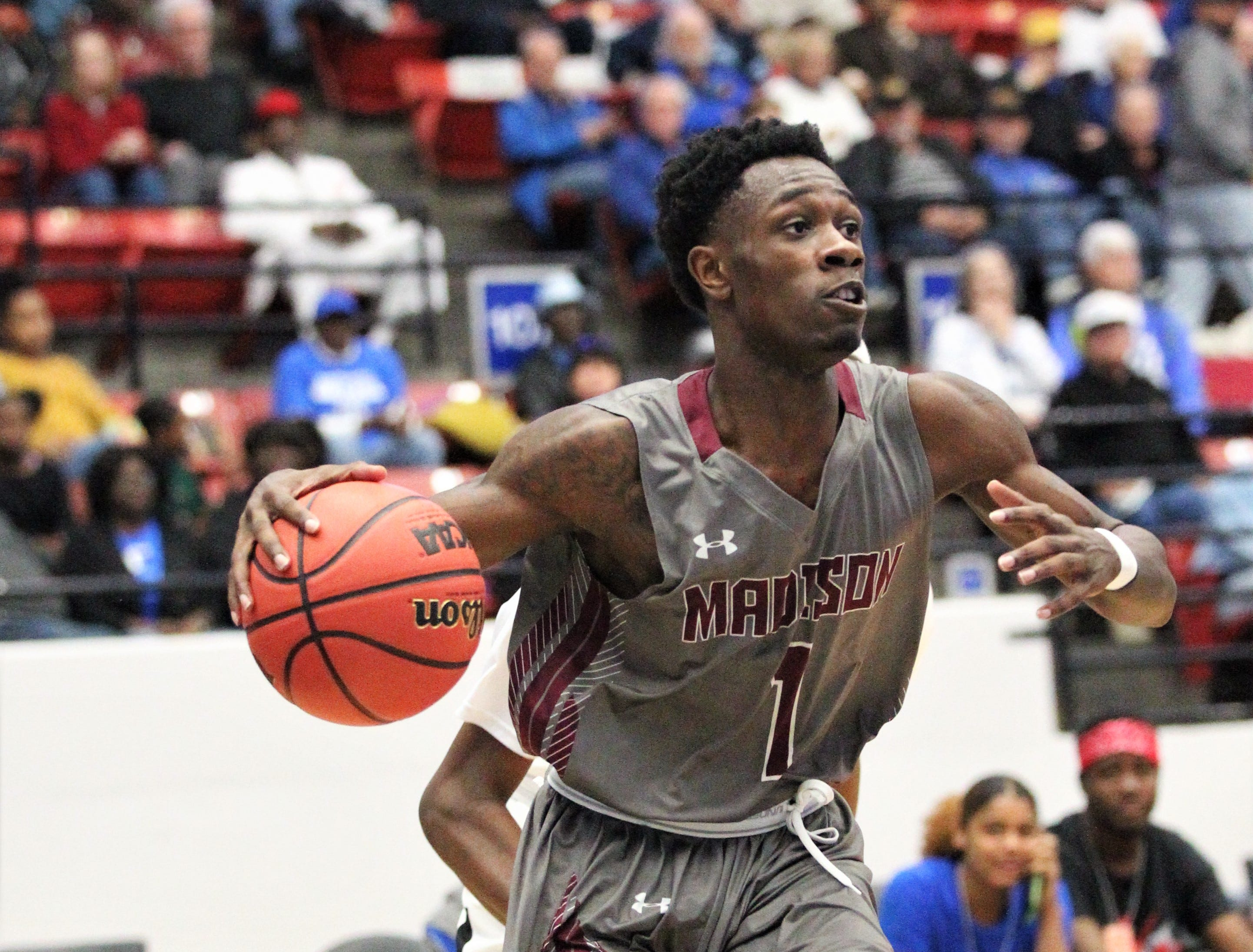 Madison County's basketball team captured a Class 1A state championship with a 62-60 overtime victory against Wildwood at the RP Funding Center in Lakeland on Tuesday.