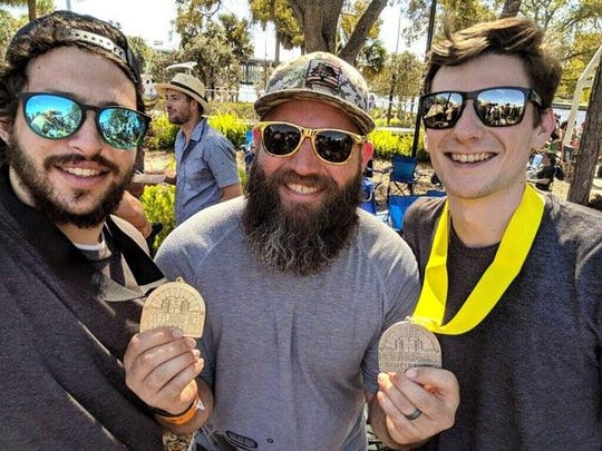 Deep Brewing assistant brewers John Meyers, left, and Clayton Henderson, right, joined Deep owner and head brewer Ryan LaPete this past weekend at the Best Florida Beer competition, where Deep won a silver and a gold medal for its beers Jack Brown and REEFraction.