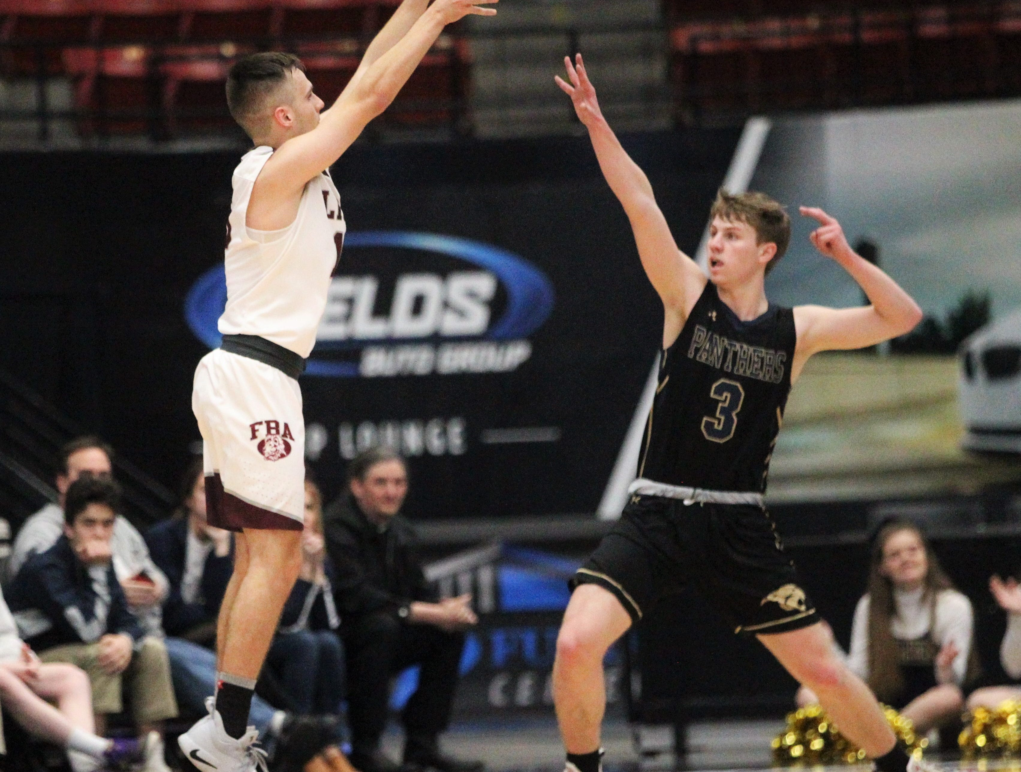 First Baptist Academy's Preston Urbancic shoots a 3-pointer as St. John Paul II beat FBA 55-37 during a Class 3A state championship game at the RP Funding Center in Lakeland on March 4, 2019.
