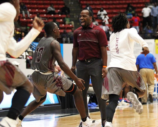 Madison County basketball coach Allen Demps celebrates as the Cowboys captured a Class 1A state championship with a 62-60 victory over Wildwood at the RP Funding Center in Lakeland on Tuesday.