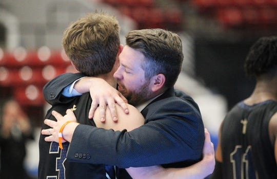 St. John Paul II coach Titus Nixon hugs Patrick Copenhaver after the Panthers beat First Baptist Academy 55-37 during a Class 3A state championship game at the RP Funding Center in Lakeland on March 4, 2019.