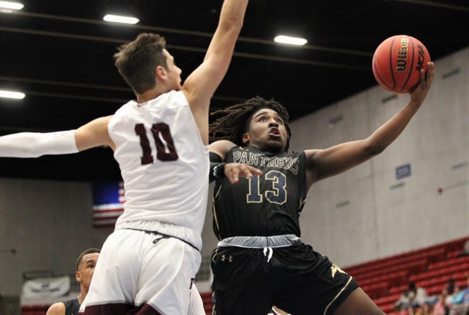 St. John Paul II's Tyreke McElwain goes up for a layup as the Panthers beat First Baptist Academy 55-37 during a Class 3A state championship game at the RP Funding Center in Lakeland on March 4, 2019.