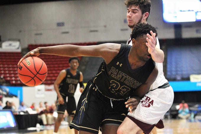 St. John Paul II's Chosen Levarity tries to drive baseline against First Baptist Academy's Trevor Travy as the Panthers beat FBA 55-37 during a Class 3A state championship game at the RP Funding Center in Lakeland on March 4, 2019.