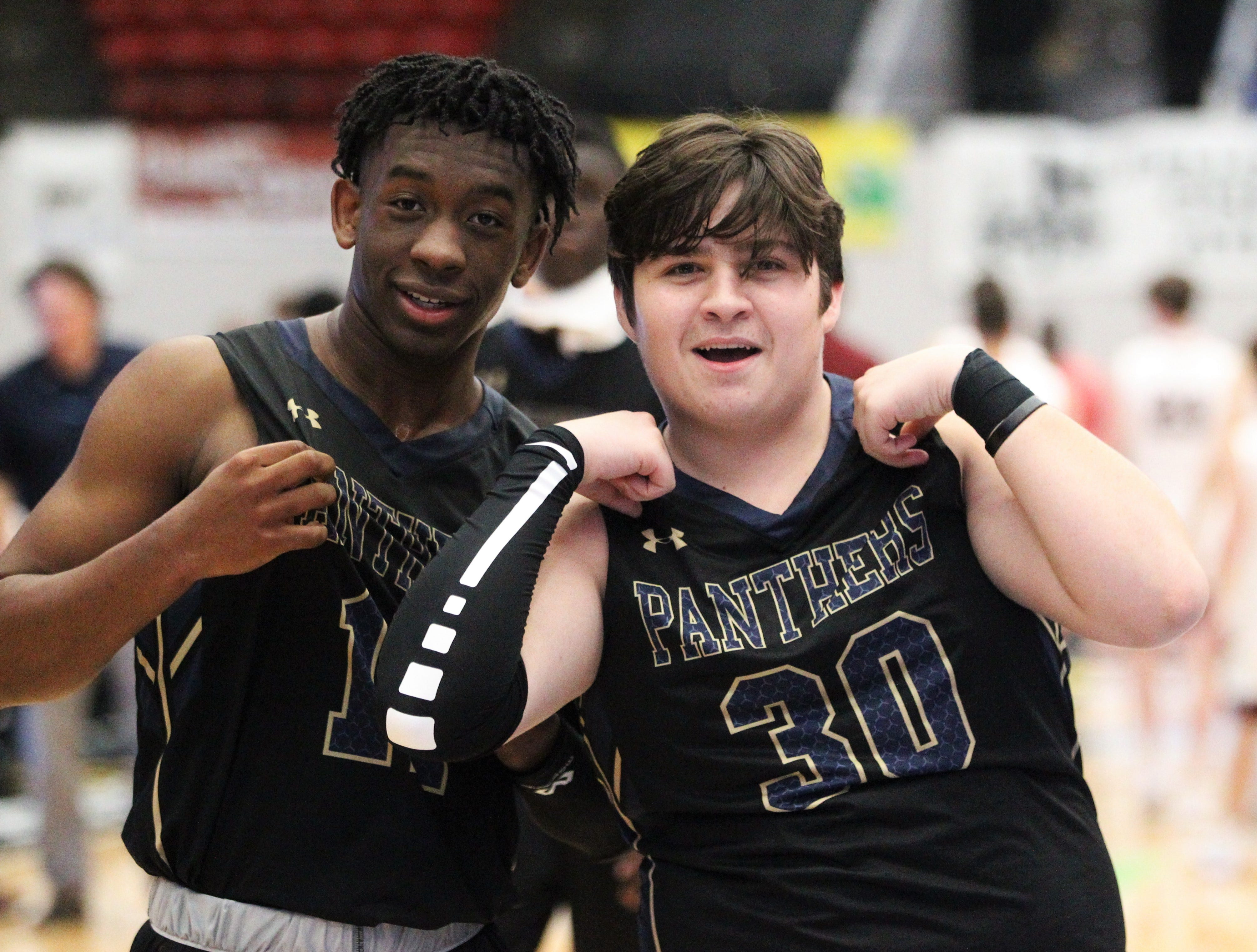 St. John Paul II's Logan Roberts and Brendan Deanda celebrate after the Panthers beat First Baptist Academy 55-37 during a Class 3A state championship game at the RP Funding Center in Lakeland on March 4, 2019.