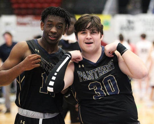 St. John Paul II's Logan Roberts and Brenden Deanda celebrate after the Panthers beat First Baptist Academy 55-37 during a Class 3A state championship game at the RP Funding Center in Lakeland on March 4, 2019.