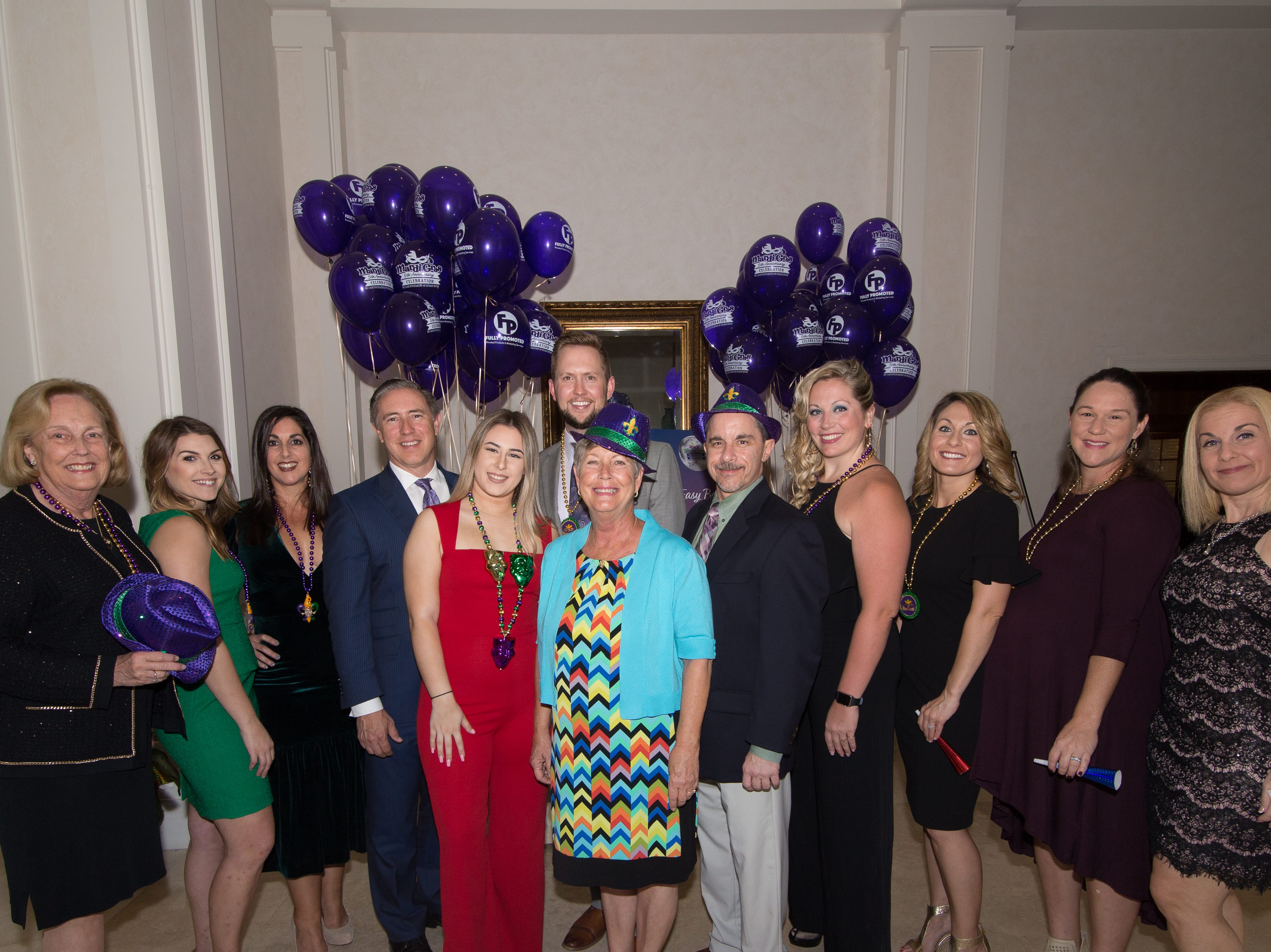 The 2019 Mardi Gras Krewe spent months planning this year's celebration. Pictured are, from left, Diana Start, Caitlin Rice, Hala Laviolette, Jay Rinchack, Lyndsay Marone, Ben Earman, Shelley Stuven, Brian Hartman, Jennifer Courtney, Stephanie Nelson and Maria Zambigadis.