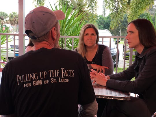 Jay Hartley, left, Stephanie Cunningham and attorney Mara Hatfield discuss glioblastoma cases in Fort Pierce Tuesday. Cunningham and Hartley are part of a support group, GBM of St Lucie.