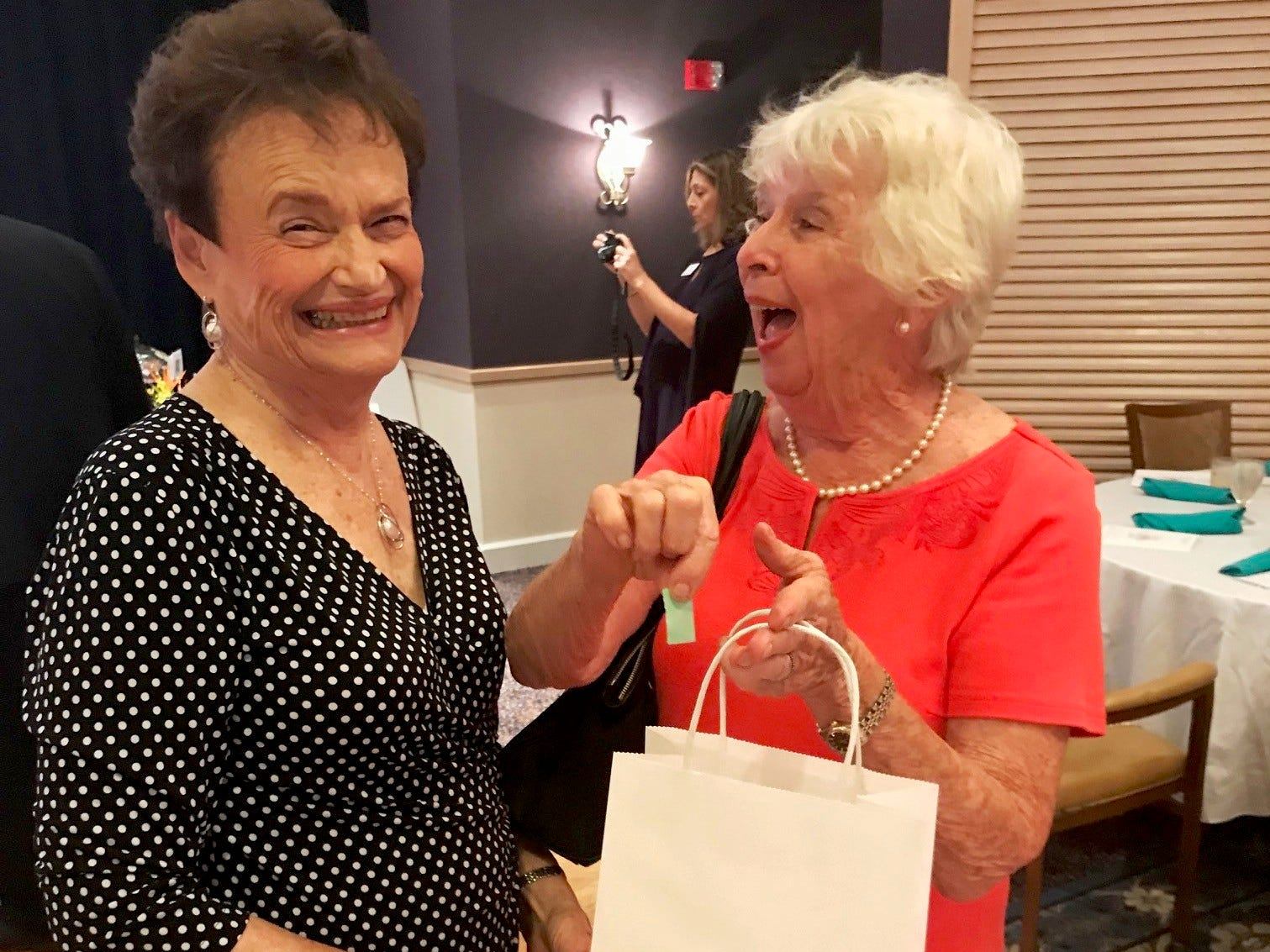 Jan Stoorza, left, and Erne Fridele share a laugh at the Kick-off Gala for Garden Club of Stuart's Secret Gardens Tour.