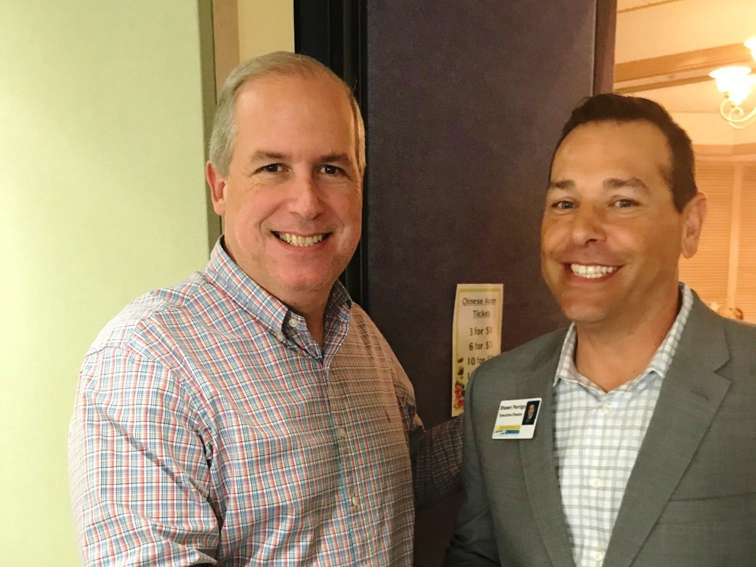 Martin County Commissioner Ed Ciampi, left, and Shawn Perrigo, executive director of Sandhill Cove Retirement Living, at the Kick-off Gala for Garden Club of Stuart's Secret Gardens Tour.