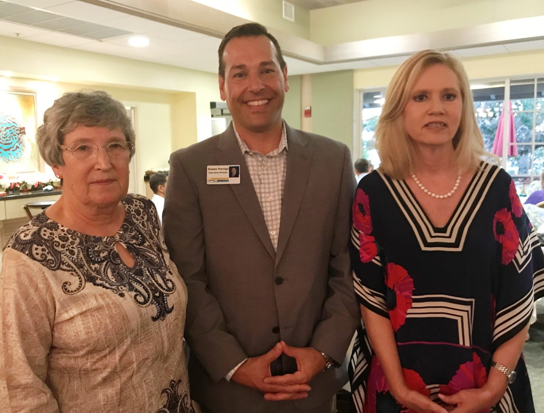 Garden Club of Stuart President Sandy Decker, left, with Shawn Perrigo, Sandhill Cove Retirement Living executive director and Jill Burton, Sandhill Cove marketing director, at the Kick-off Gala for Garden Club of Stuart's Secret Gardens Tour.