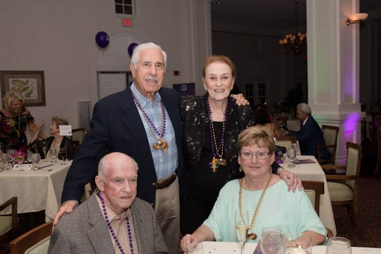 Earl Walker, left, Jack Weisbaum, Mary Weisbaum and Kathy Hendrix enjoy a beaded and festive Mardi Gras evening at the We Care Foundation party at Oak Harbor Club.