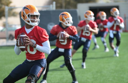 The UTEP quarterbacks, including newcomer T.J. Goodwin, foreground, warm up before their first spring practice Tuesday, March 5, 2019, at Glory Road Field.