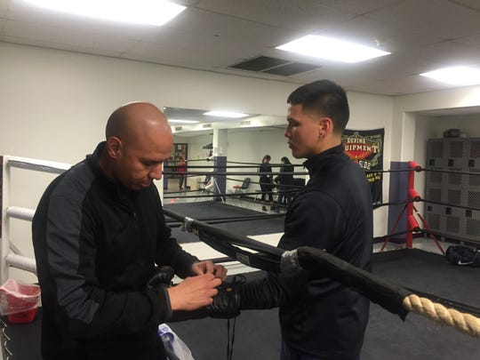 El Paso amateur boxer Jorge Tovar Jr., right, is among the nation's top fighters at 165 pounds. His dad, Jorge Tovar Sr., left, is his trainer.