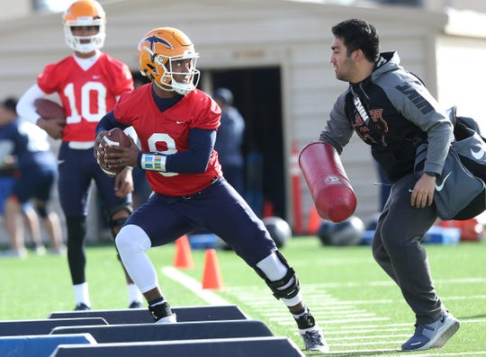 UTEP quarterback Brandon Jones runs a drill during practice Tuesday, March 5, 2019, at Glory Road Field.