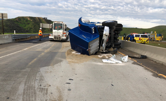 A dump truck full of sand tipped over Tuesday morning on Highway 118, causing traffic delays.