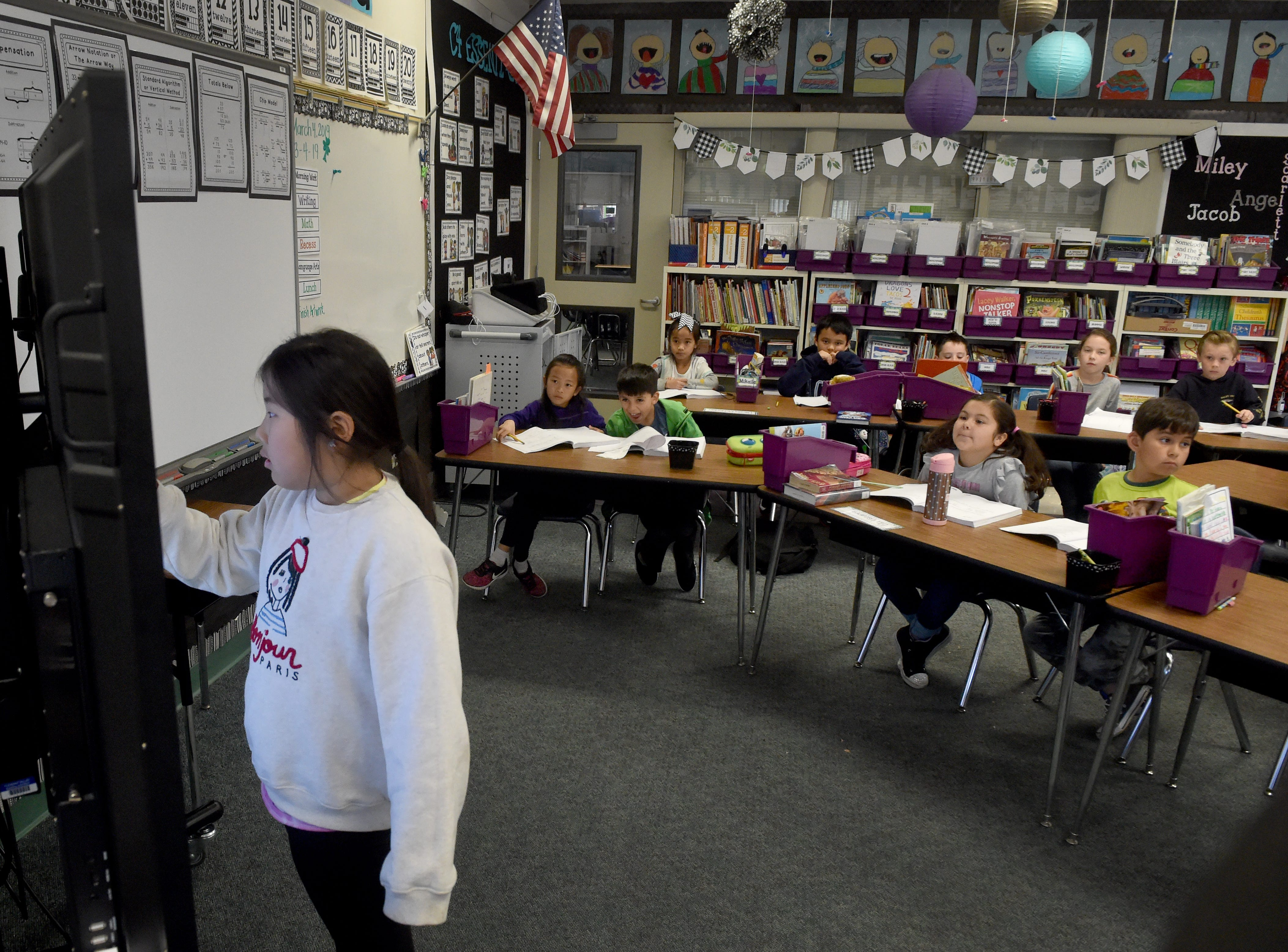 Hailey Song, a second-grader at Mariposa School in Camarillo, uses a new touch-screen display during class on a recent Monday. The Pleasant Valley School District is using funds from Measure C to purchase technology for the classrooms.