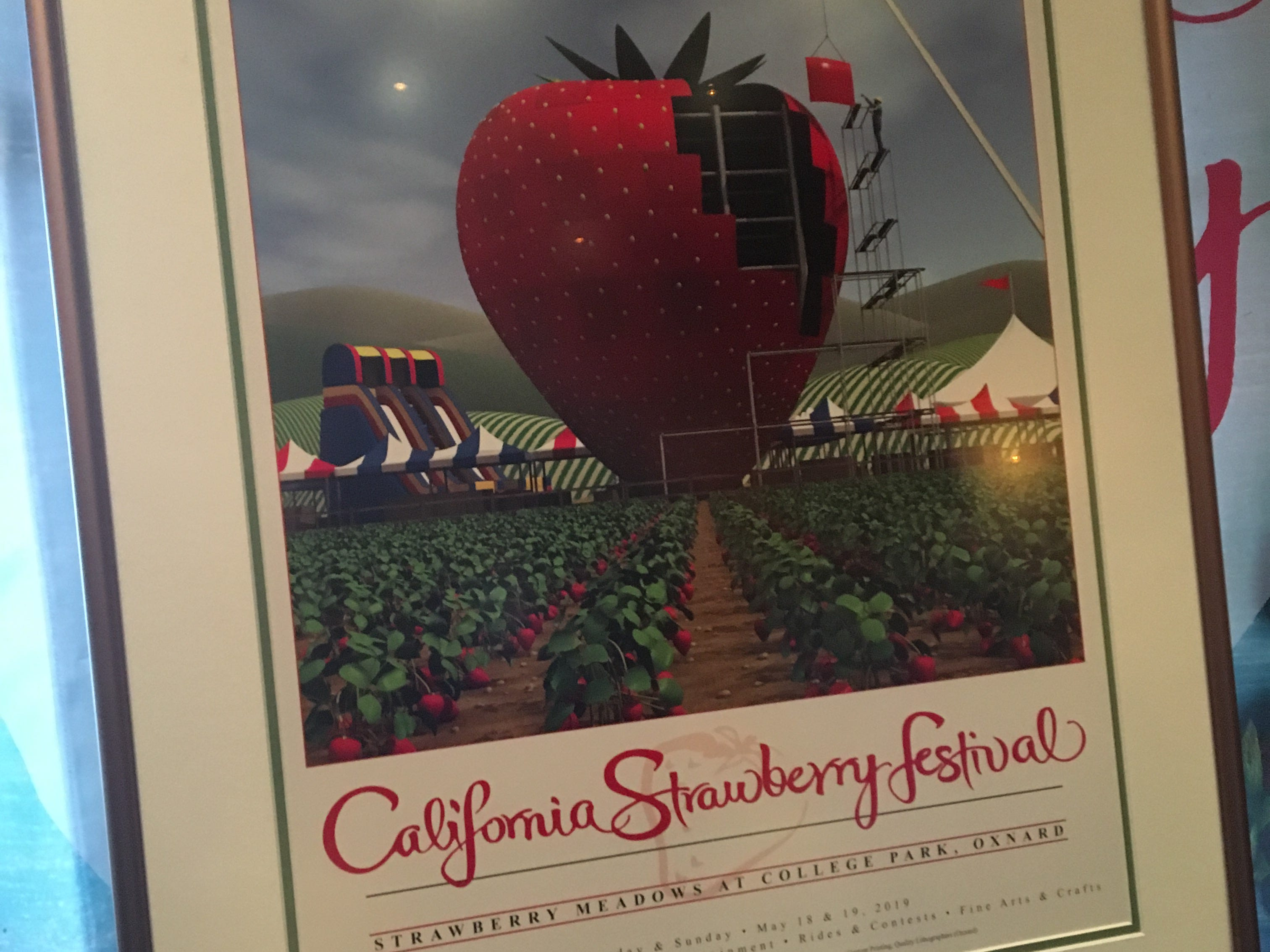 The official poster of the 36th Annual California Strawberry Festival was unveiled at a ceremony Tuesday at Yolanda's Mexican Cafe in Oxnard.
