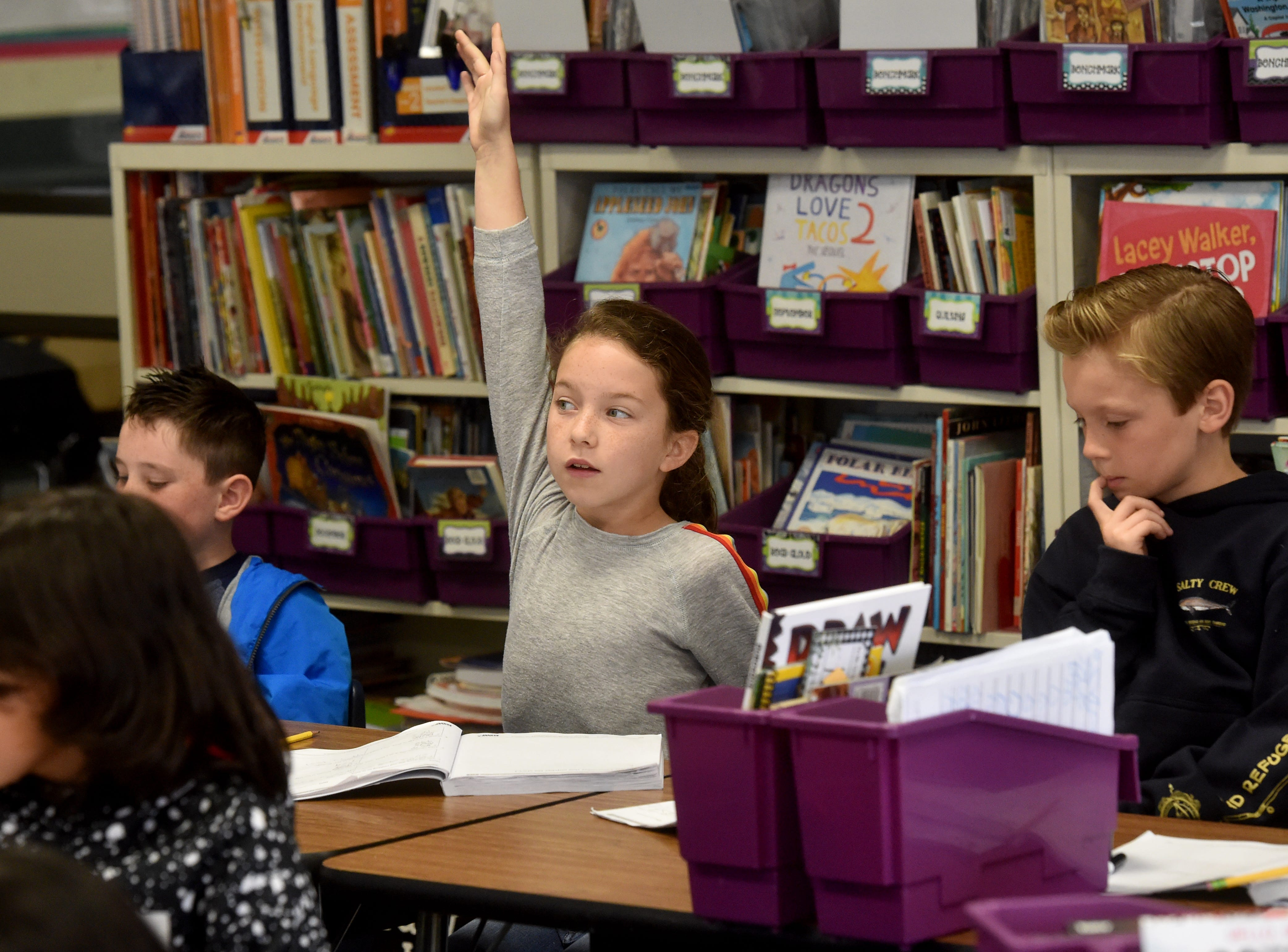 Sienna Goden, a second-grader at Mariposa School in Camarillo, volunteers to answer a math question using a new touch-screen display during class on a recent Monday. The Pleasant Valley School District is using funds from Measure C to purchase technology for the classrooms.