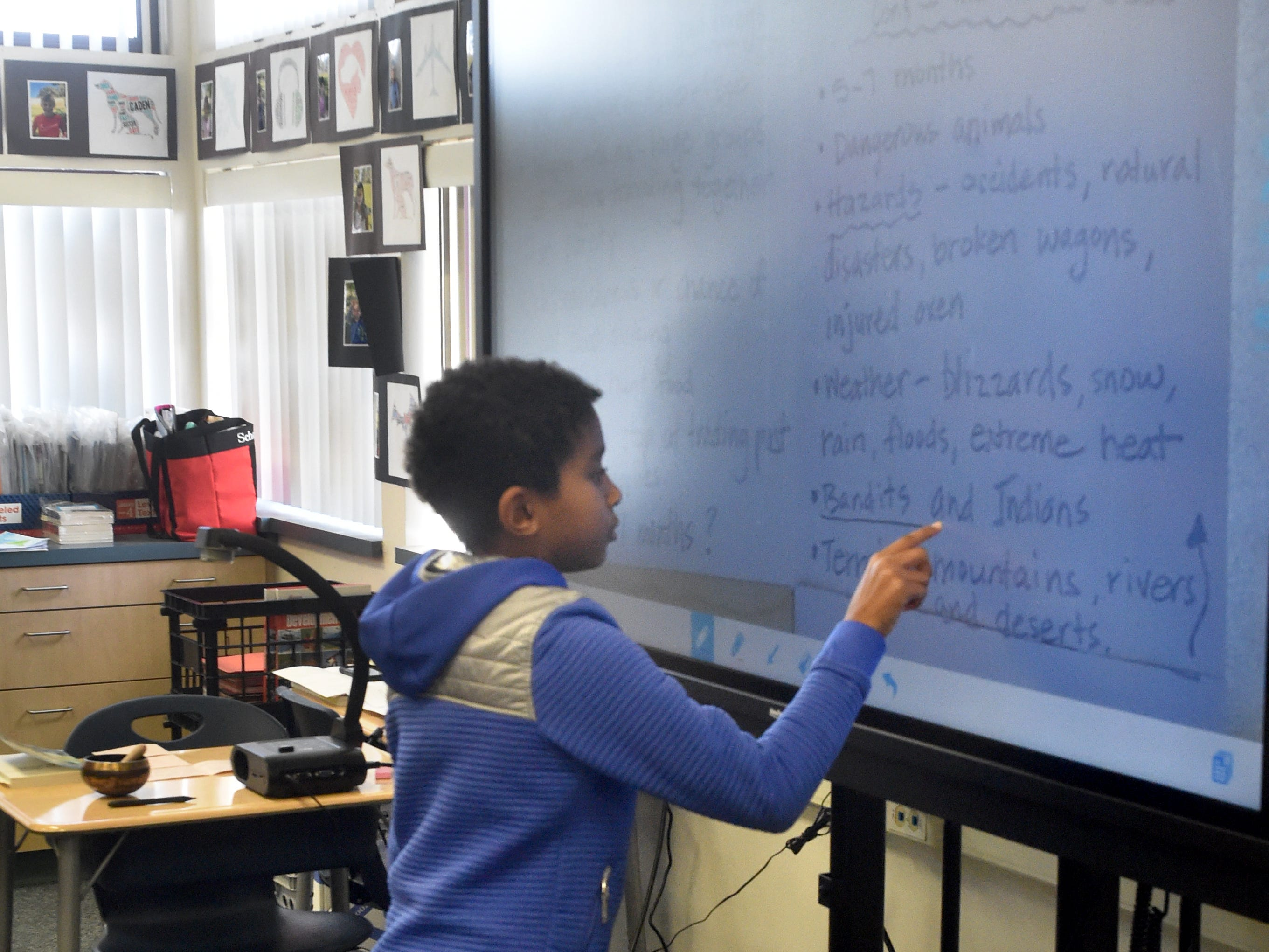 Jalen Oben, a fourth-grader at Mariposa School in Camarillo, uses a touch-screen display during class on a recent Monday. The Pleasant Valley School District is using funds from Measure C to purchase technology for the classrooms.