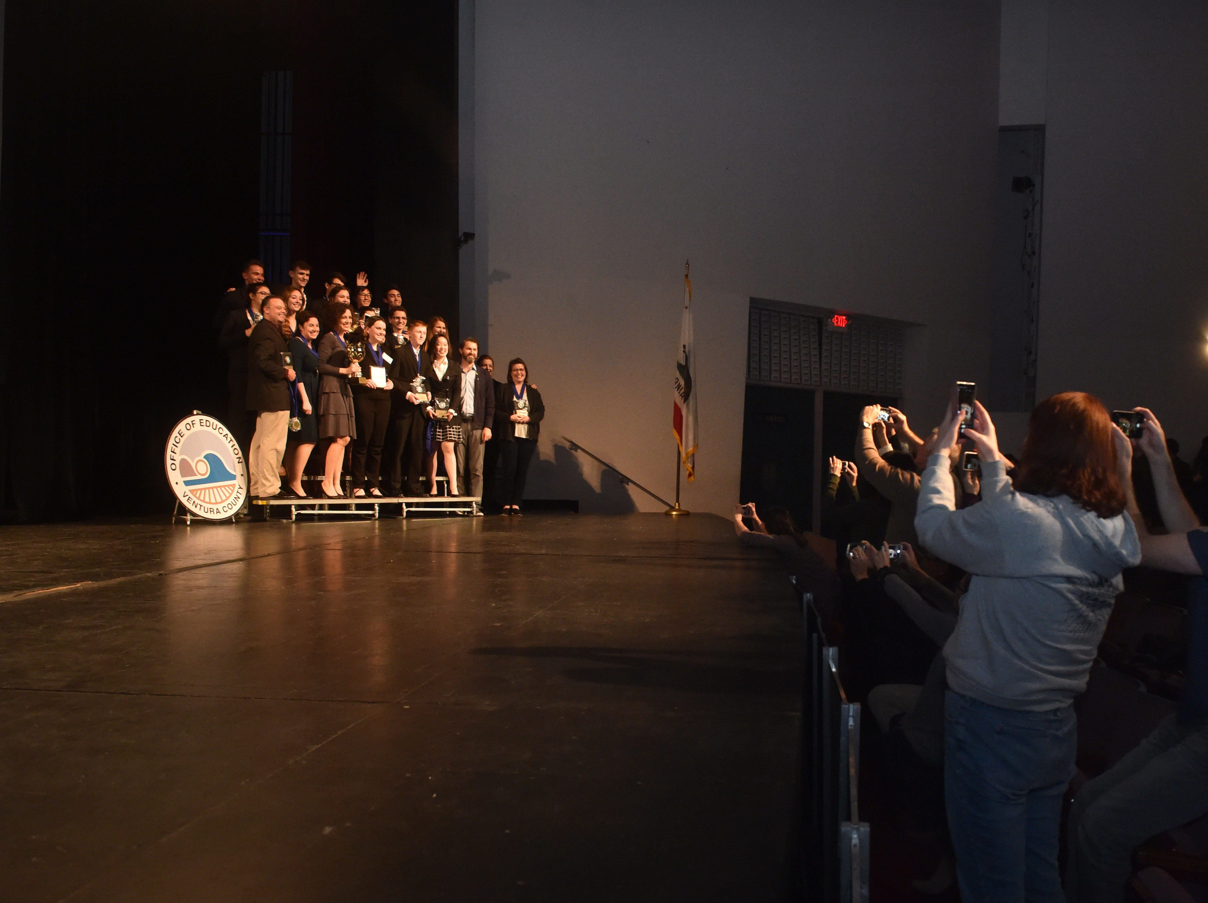 The Trinity Pacific mock trial team poses on stage after being announced the winners of the Ventura County Mock Trial Competition on Monday.