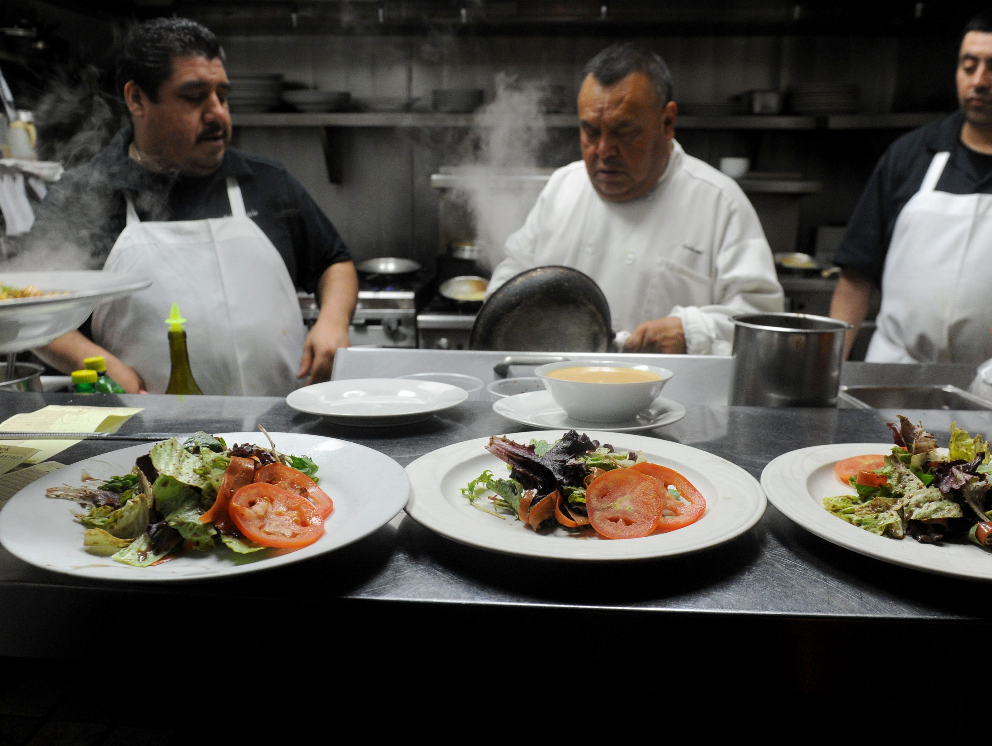 Augustine Resendiz, from left, Gabriel Navarrete and Luis Patino, cooks at Bistro 13 in Camarillo, prepare dishes for customers. The Italian-centered is owned by Giovanni Tromba.