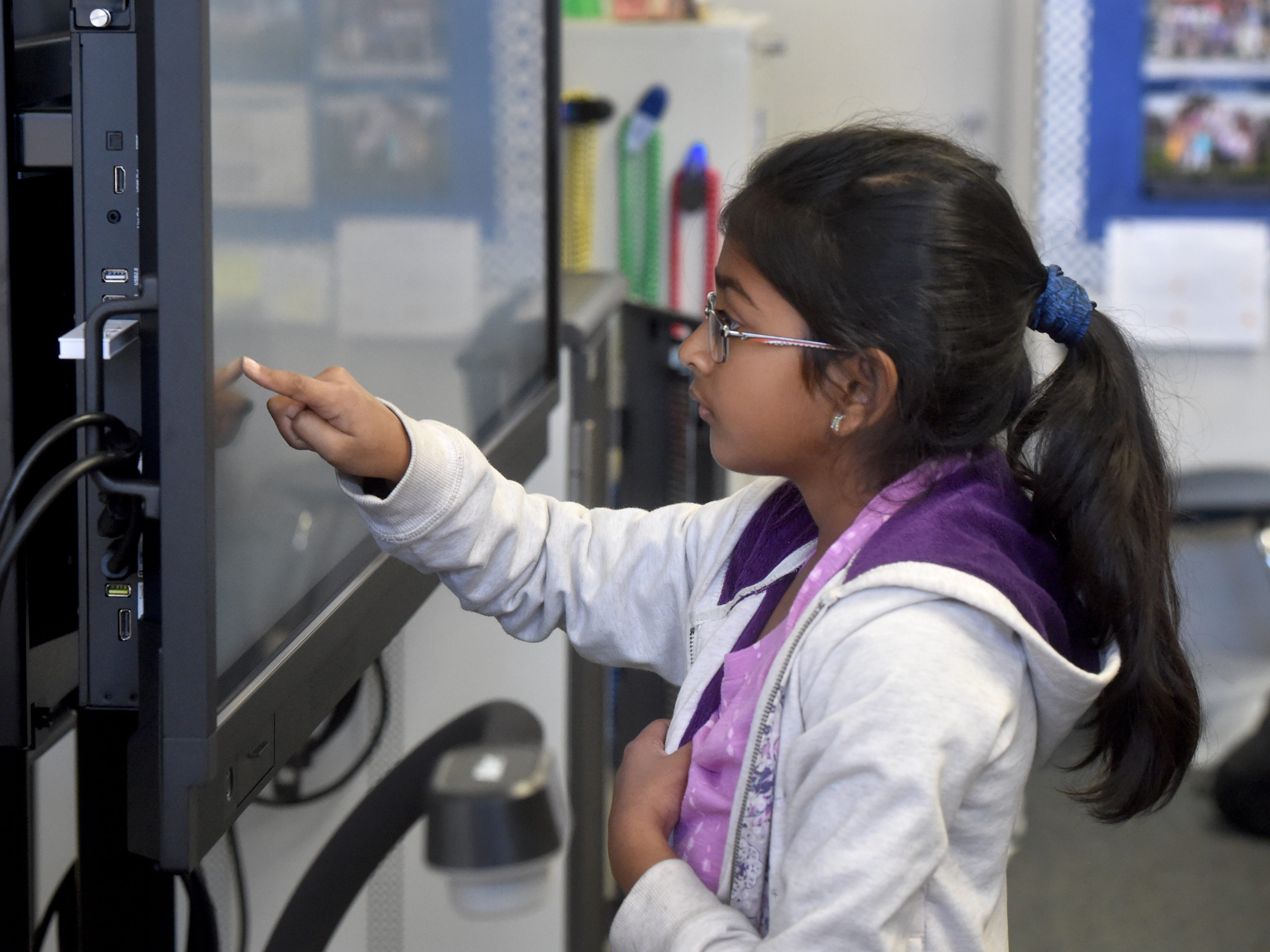 Karvi Patil, a fourth-grader at Mariposa School in Camarillo, answers questions using touch-screen display during class on a recent Monday. The Pleasant Valley School District is using funds from Measure C to purchase technology for the classrooms.