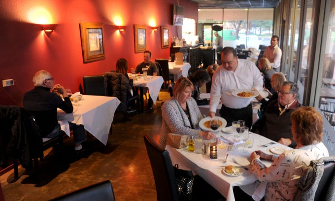 Chuy Perez serves Shelly Loving and her parents Ernie Chavis and Nancy Chavis at Bistro 13. The Italian-centered restaurant is located in Camarillo and is owned by Giovanni Tromba.